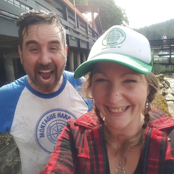 Marina owner, Mike Byzyna and Manager, Amber Reid having fun power washing the new restaurant!